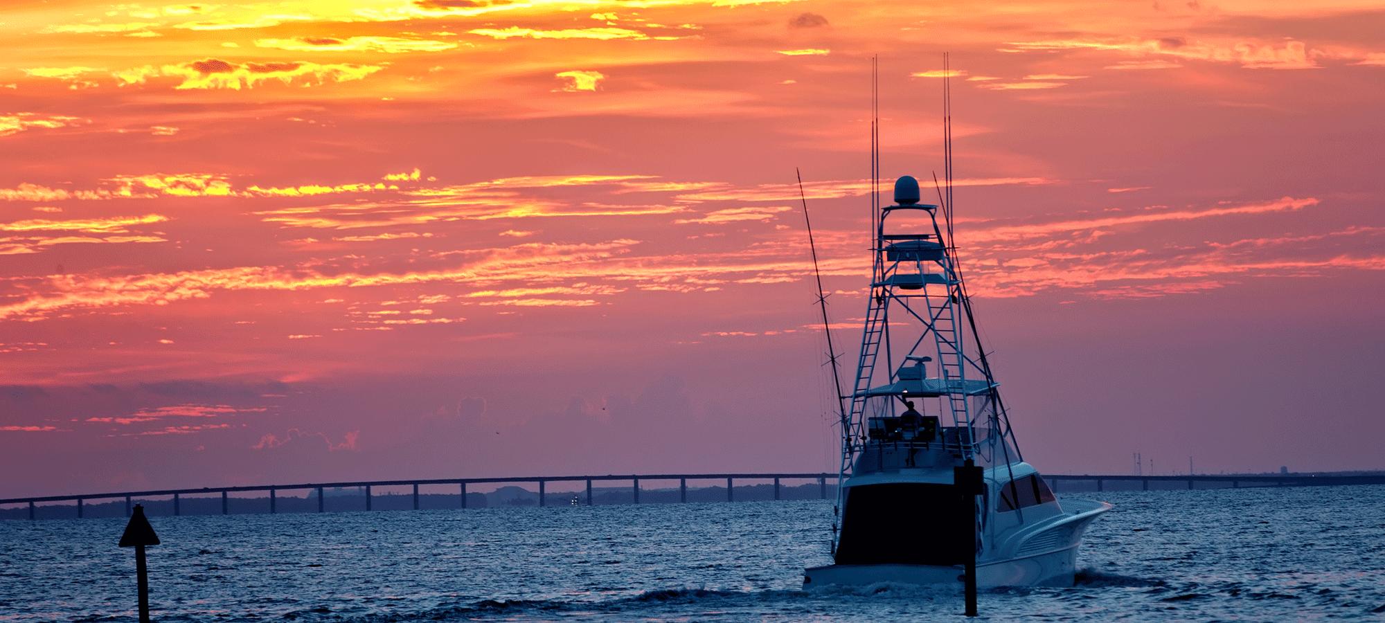destin fishing boat at sunset